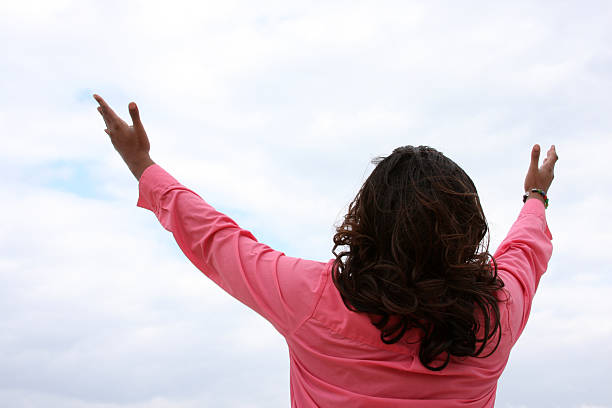 African American Woman Lifting Arms to Heaven